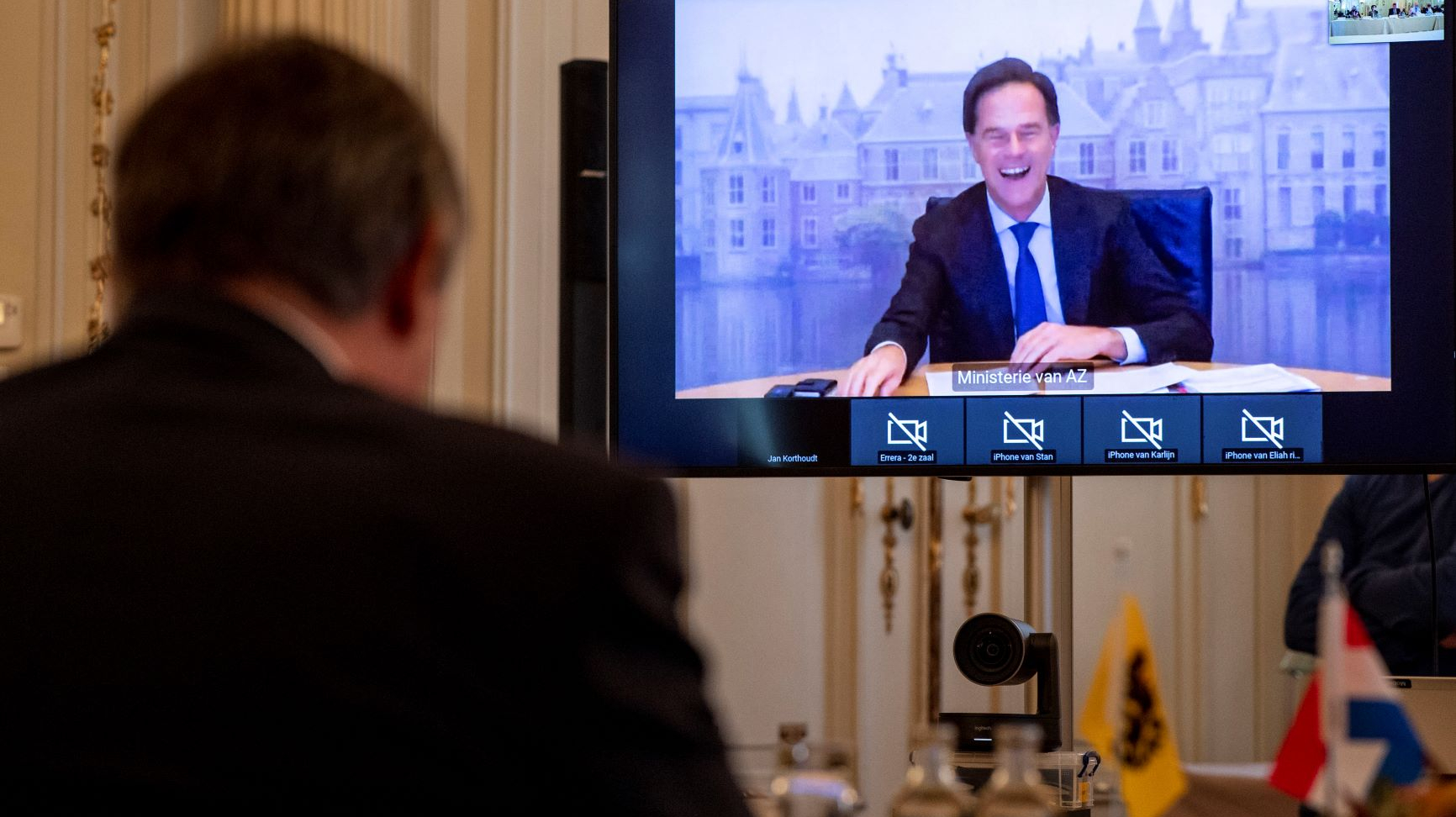 minister-president Jambon in meeting with minister-president Rutte on screen